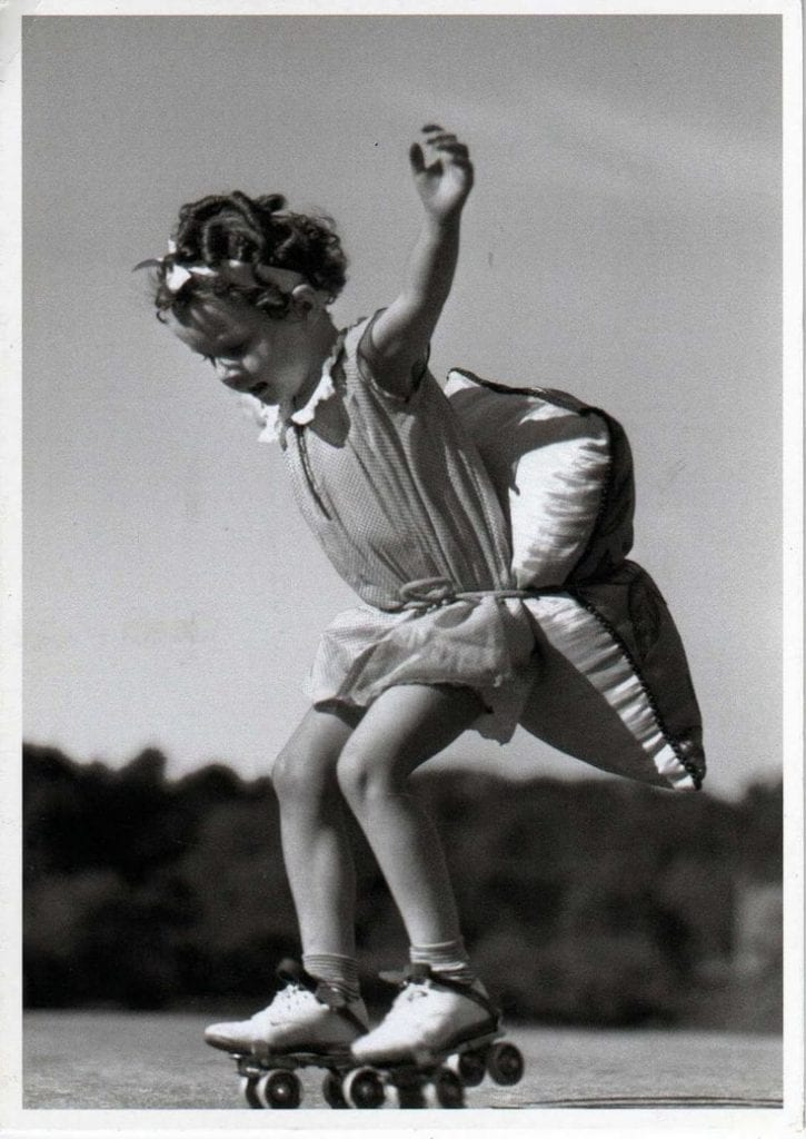 Little girl skater with pillow - history of roller skating