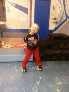 photo of Conner with his skates on at 3 years old